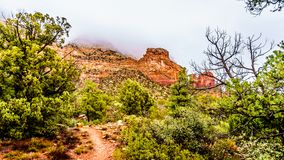 Clouds hanging over the Lower Chimney Rock Trail, a hiking trail to Chimney Rock, a sandstone butte at the town of Sedona royalty free stock photos