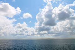 Clouds hanging over the sea. stock image