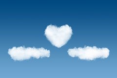 Clouds and heart backdrop on sky background Stock Photos