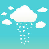 Clouds with hearts. Rain drops of red hearts in the blue sky Stock Photo