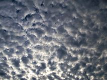 Clouds from Heaven. This is some clouds up in the sky with some sun shining one day Royalty Free Stock Photography