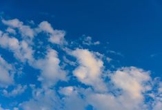 Clouds and heavens. White clouds against the blue sky Stock Image