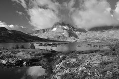 Clouds high sierra lake Stock Images