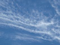 High Thin Cloud Foretell. When clouds are high and thing, it means a weather system is moving in. An old forecast that farmers relied on because it was true royalty free stock photo