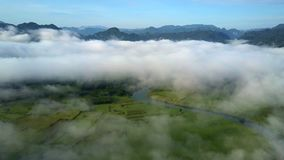 Clouds on hill top level and valley visible downwards stock footage