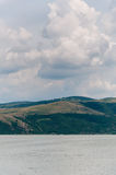 Clouds and hills by the Danube river Stock Images