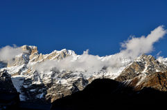 CLouds and himalayas. A patch of cloud covers the himalayan range Royalty Free Stock Photo
