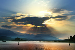Through clouds. Ho Nui Coc lake - Thai Nguyen - Viet Nam Royalty Free Stock Photos