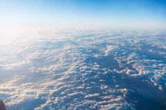 Clouds and horizon from airplane. Above view of clouds and horizon from airplane Stock Photo