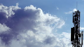 Clouds on hot blue sky with network tower stock video footage