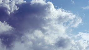 Clouds on hot blue sky stock footage