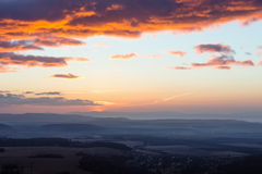 Clouds illuminated by morning sun over valley. Stock Images