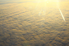 Clouds illuminated by the sun, flying above the clouds Royalty Free Stock Photo