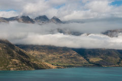 Clouds inversion above lake Wakatipu Royalty Free Stock Image