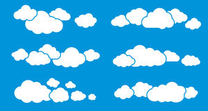 Clouds Isolated on Blue. Clouds Collection. Clouds set. Cloud isolated on blue sky background. Cloud symbols. Cloud groups. Clouds flat icons. Collection of Royalty Free Stock Image