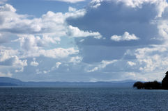 Clouds and lake. Afternoon clouds over the lake Villarrica in Pucon, Chile Stock Photo