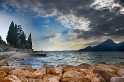 Clouds on the lake. Dark clouds over the Garda lake in Italy Royalty Free Stock Photography
