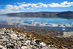 Clouds on the lake. Tolbo-Noor in Mongolia Royalty Free Stock Image