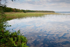 Clouds in the lake. Cloudy sky mirrored in the lake. Ukraine Stock Photos