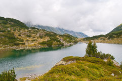 Clouds and Lake on Mountain Pirin Royalty Free Stock Photography