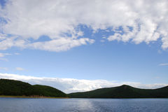 Clouds and lakes royalty free stock images