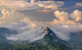 Clouds landscape on mountain. Mountain landscape after rain, Romanian Carpathians Stock Photos
