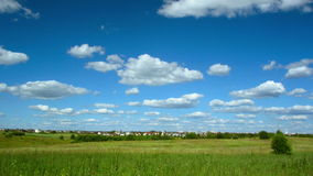 Clouds landscape and village stock footage