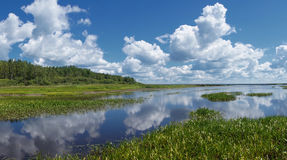 Clouds. Landscape with the clouds which are reflected in the river Stock Image