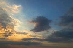Clouds with light rain, the sun is about to fall evening. Stock Images