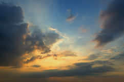 Clouds with light rain, the sun is about to fall evening. Royalty Free Stock Photos
