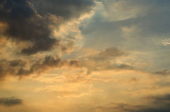 Clouds with light rain, the sun is about to fall evening. Stock Photography