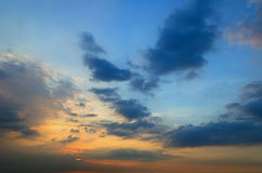Clouds with light rain, the sun is about to fall evening. Royalty Free Stock Images