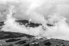 Clouds like a big wave on a hill in italy, tuscany Stock Image