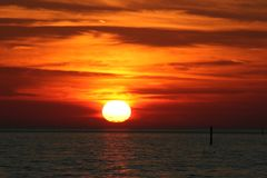 Gulf of Mexico sunset looks like molten lava. royalty free stock image