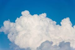 Clouds that look like fluff. The color contrasts with the dark sky background stock images