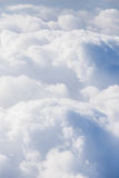 Clouds look out a plane. Blue sky clouds look out a plane royalty free stock photo