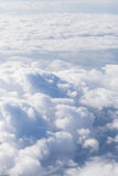 Clouds look out a plane Royalty Free Stock Image