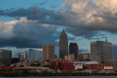 Cleveland Ohio skyline at sunset. Clouds loom over downtown Cleveland city skyline royalty free stock photography