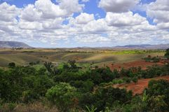 Clouds  of madagascar. Landscape of the high plateau of madagascar, rice fields under the fabulous clouds Royalty Free Stock Images
