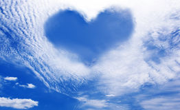 Clouds making a heart shape againt blue sky Royalty Free Stock Photo