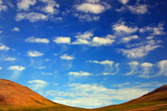 clouds maneten arkivbild