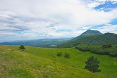 Clouds and meadow on the puy de dome. In wide angle Stock Photo