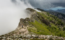Clouds meet the top of a mountain ridge on GR20 in Corsica Royalty Free Stock Photography