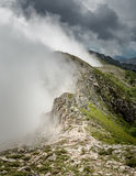 Clouds meet the top of a mountain ridge on GR20 in Corsica Stock Image