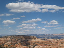 Clouds and Mesas. Cumulus clouds float above the far reaches of Bryce Canyon and Grand Escalante, Utah Stock Images