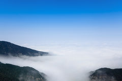 Clouds and mist floating among mountain peak Royalty Free Stock Photos