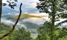 Clouds over Mountain valley, Waynesville NC, USA. Clouds and mist in the mountain valley forest. Photographed from Ratcliff Mountain overlooking Waynesville Royalty Free Stock Photo
