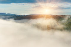 Clouds and mist  after the rain on the hills. Stock Photo