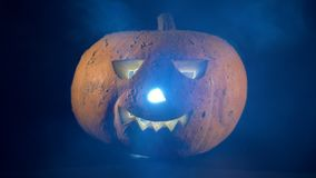 Clouds of mist are spreading along a halloween jack-o-lantern. 4K stock video
