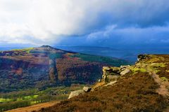 Clouds and mists gather over Win Hill and Bamford Edge, in Derbyshire. Taken to capture the rich colourations and varied terrain, surrounding Bamford Edge, in royalty free stock image